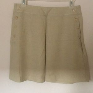 Lil' beige mini skirt with buttons up both sides